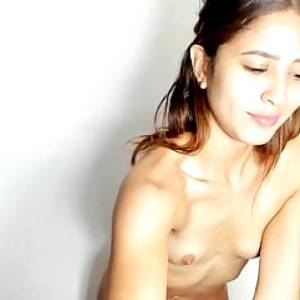 Brunette girl with sweet tiny tits in front of webcam